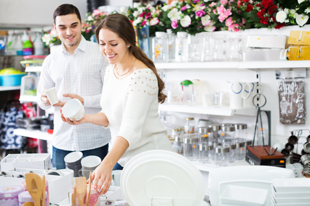 Customers chooses ceramic cup in the store Stock Photo