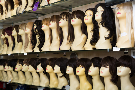 peruke: Dummies heads with modern hair style periwigs in a shop