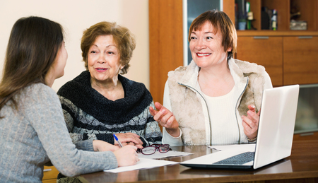 75s: Senior satisfied women making will at public notary office and smiling