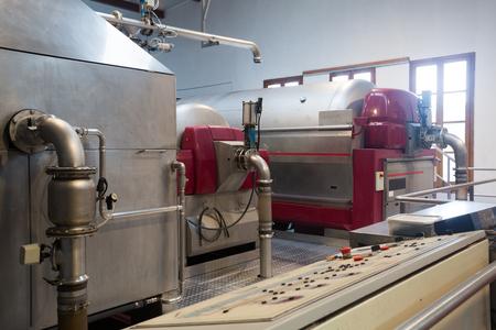 crushing: Grape pressing and crushing machines in wine plant