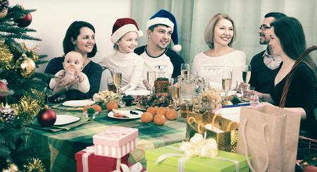 grandad: Smiling kids and grandchildren Celebrating Christmas with grandad and granny