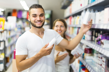 man buying cosmetical cream in the shopping mall