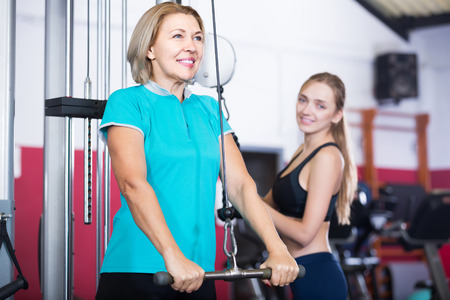anaerobic: happy spanish females of different age strength training in gym for women