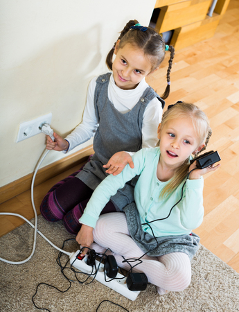 happy children playing with sockets and electricity indoors