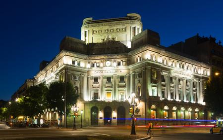 catalunya: BARCELONA, SPAIN - SEPTEMBER 8, 2015: Caixa Catalunya Bank at Barcelona in night time. Catalonia, Spain