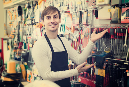 tooling: adult spanish male seller posing at tooling section of household store Stock Photo