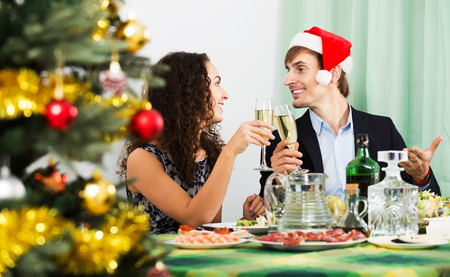 celebrate year: Young positive family celebrate the New Year in home interior. Focus on man Stock Photo