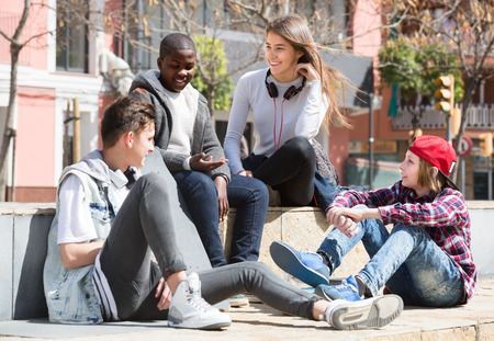 blabbing: teens spending time together and talking in may day