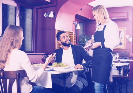 middle class: Positive smiling spouses having date in middle class restaurant