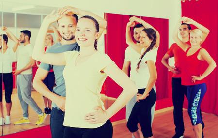 latino dance: Cheerful people dancing Latino dance in class Stock Photo