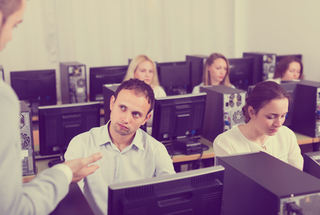 criticize: Angry sales department manager displeased of employees at open space office