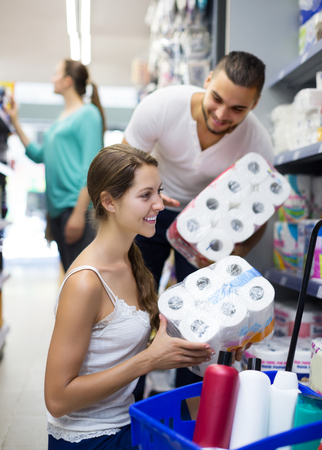 Positive people buying bath tissue in the shopping mallin the shopping mall