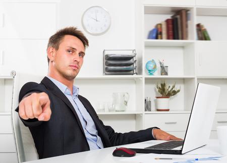 formalwear: Business man wearing formalwear working on laptop at office
