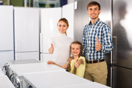 household appliance: cheerful  customers shopping in household appliance store