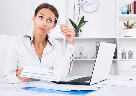 experiencing: frustrated young woman experiencing  problems at company office