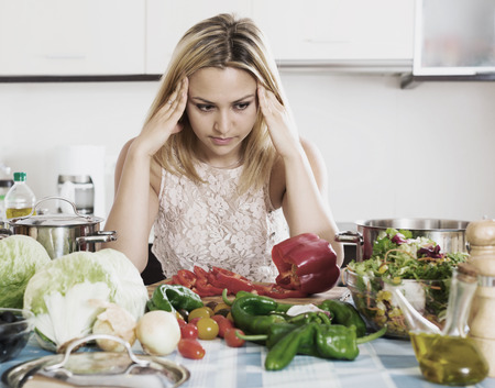 Depressed housewife thinking what to prepare for dinner