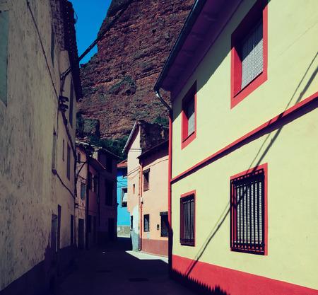 spanish village: Narrow street of  spanish village in summer. Los Fayos, Aragon