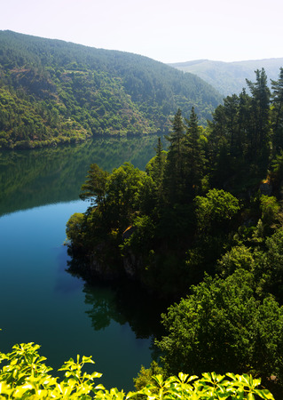 sil: Mountains lake with steep foresty banks in sunny summer day. Galicia,  Spain
