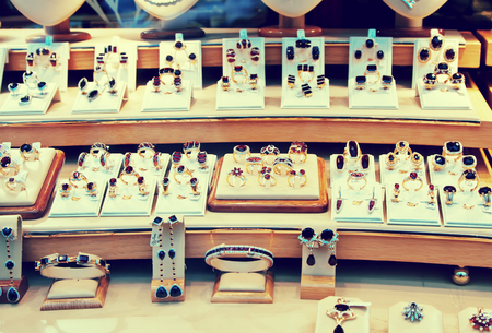 14k: counter with garnet jewelry in store window Stock Photo