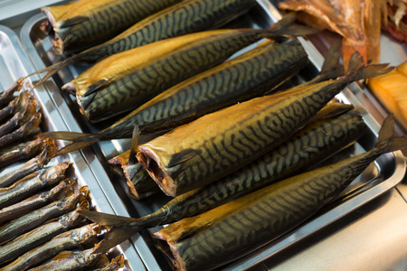 Trays with smoked fish in supermarket of Russian food Stock Photo
