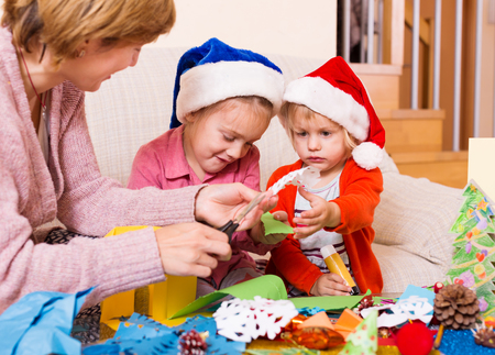 mother with two daughters preparing for Christmas