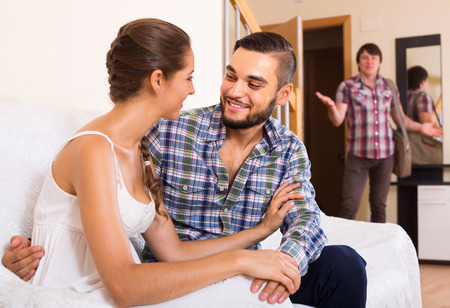 discovering: Upset adult discovering cheating girlfriend at home