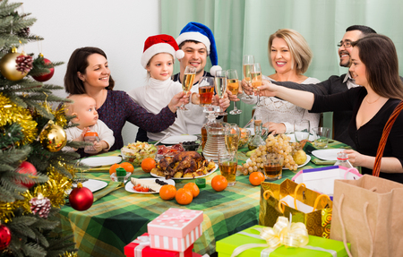 relatives: Relatives celebrate Christmas at  table in home Stock Photo