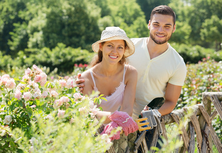 floriculturist: Young family is engaged in gardening Stock Photo