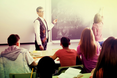 answering: Pupils listening the explanation and answering to positive teacher in the math course