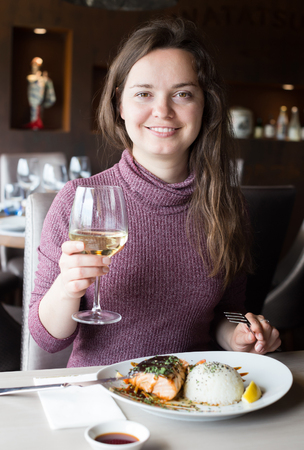 Woman spending her time in restaurant with delicious meal