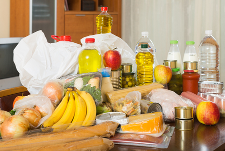aliments: foodstuffs of supermarket on  table in home