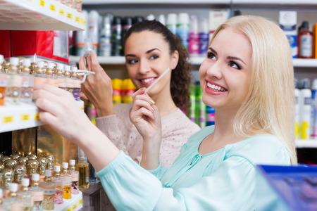 eau de perfume: Portrait of female customers shopping in beauty store