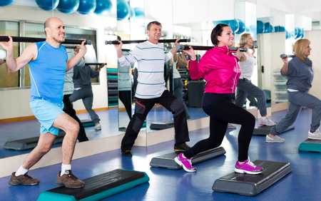 european people: Group of happy european people exercising in a fitness club