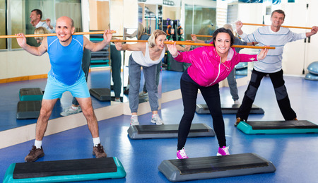 lifestile: Group of cheerful  men and women training in a gym