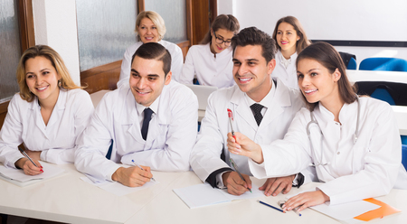 adult smiling spanish health-care workers during educational program in medical school