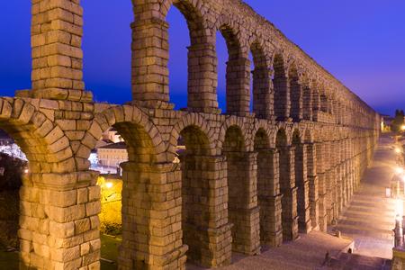Evening view of old roman aqueduct in Segovia. Spain