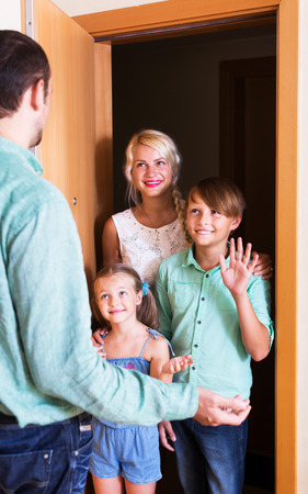 threshold: Smiling family coming at threshold with visit to friend. Focus on boy