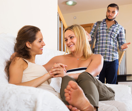 unfaithful: Love triangle: upset husband, smiling wife and lover at home interior