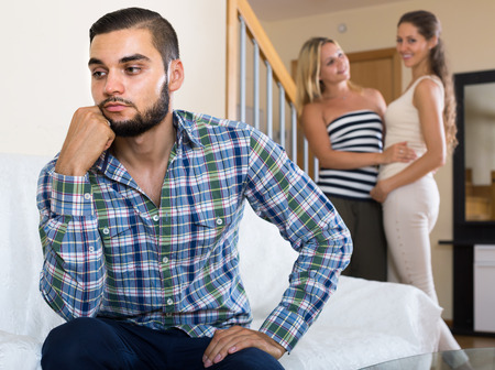 polygamy: Offended american person keeping silence turned away from friends