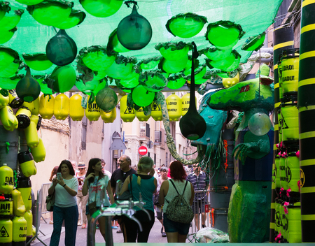 toxic waste: BARCELONA, SPAIN - AUGUST 16, 2015:   Gracia Festival Decorations in Barcelona, Spain. Each street is decorated with hand residents of the street. Theme of toxic waste Editorial