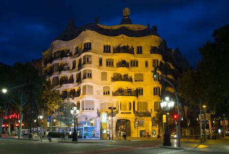 BARCELONA, SPAIN - JUNE 23, 2015: Night view of Casa Mila (La Pedrera)   in Barcelona, Catalonia. House was built in 1905–1910 by Catalan architect Antoni Gaudi Editorial