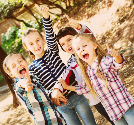 5s: Happy smiling children holding hands and giving friendship swear Stock Photo