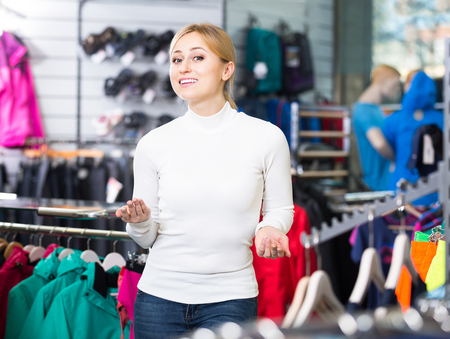 russian girl: cheerful young russian girl looks satisfied in the fashion shop