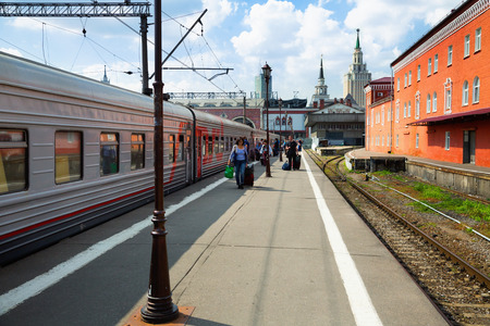 long distance: MOSCOW, RUSSIA – AUGUST 22, 2016: view on Kazansky railway central station platform with  long distance trains and passengers