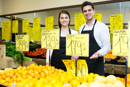 happines: Happy market workers with citrus fruits, prices on Spanish Stock Photo