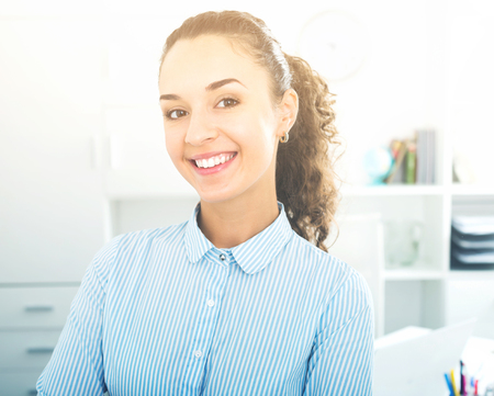 Successful and confident cheerful woman working in modern office