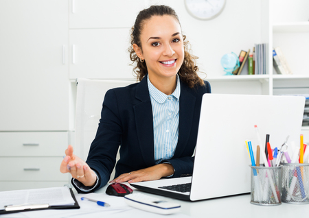 Portrait of successful business lady working in modern office