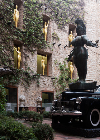 FIGUERES, SPAIN - JANUARY 03, 2016: Courtyard of The Dali Theatre and Museum (Teatre-Museu Dali) with figurines and black car installation, Catalonia