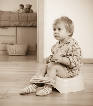 piddle: Toddler sitting on green potty