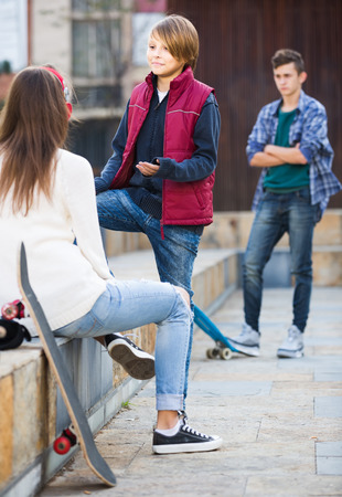 outsider: Jealous teen and his young spanish friends after conflict outdoors